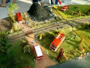 Hasenie požiaru pri trati.